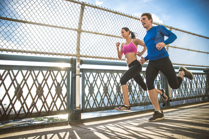 Couple running outdoors